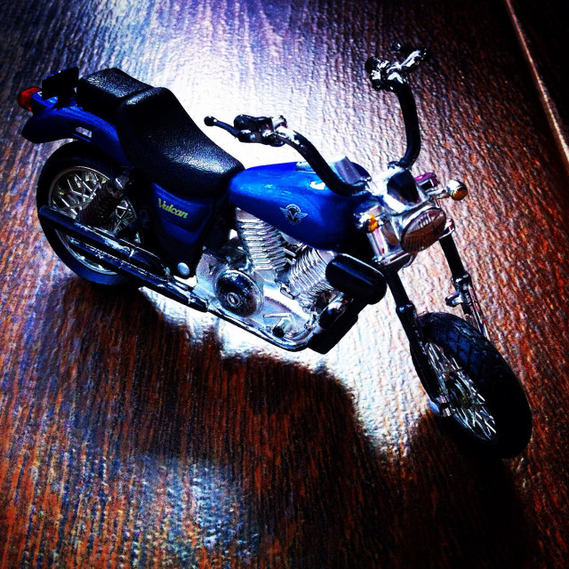 """""""Plastic motorcycle toy parked"""" stock image"""
