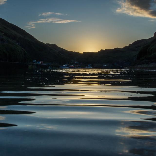 """Sun setting over Boscastle harbour"" stock image"