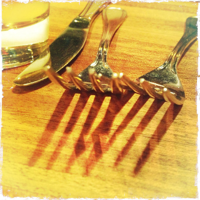 """""""Forks, knife, water, glass, restaurant, table, wood, silverware, dinnerware, dining, out, shadows, cafe, utensils, closeup, textures"""" stock image"""