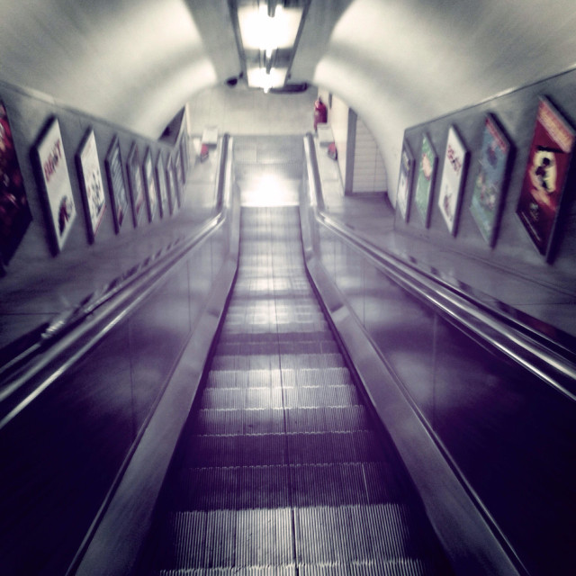 """Looking down shiny escalators, London Underground / tube"" stock image"