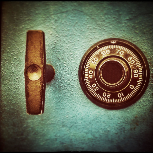"""""""Combination Lock And Handle On An Old Metal Safe"""" stock image"""