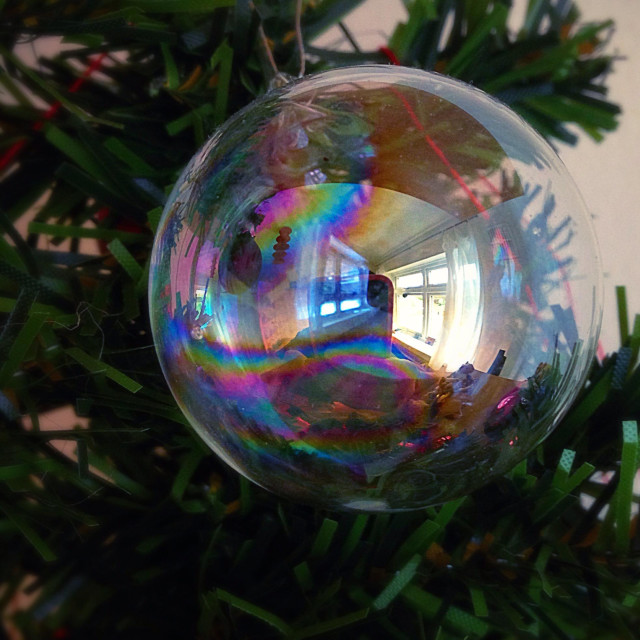 """""""Reflection of a window in a crystal ball hanging from a Christmas tree"""" stock image"""