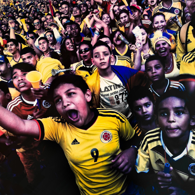 """Colombia football fans cheer while watching the match between Colombia and Uruguay at the FIFA World Cup 2014, in a park in Cali, Colombia, 28 June 2014."" stock image"