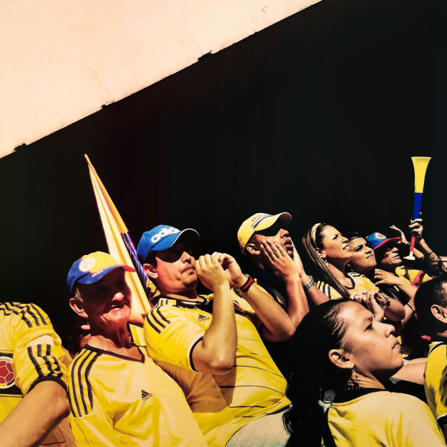 """Colombia football fans cheer while watching the football match between Colombia and Uruguay at the FIFA World Cup 2014, in a park in Cali, Colombia, 28 June 2014."" stock image"