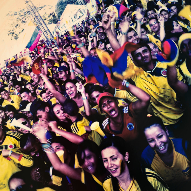 """""""Colombia football fans cheer while watching the football match between Colombia and Uruguay at the FIFA World Cup 2014, in a park in Cali, Colombia, 28 June 2014."""" stock image"""