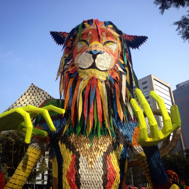 """A giant colored paper mache lion during the Parade of Alebrijes Monumentales in Reforma Avenue, Mexico City, Mexico. Artwork called ""Changoleon"" by artist Javier Adolfo Moncayo Bravo."" stock image"