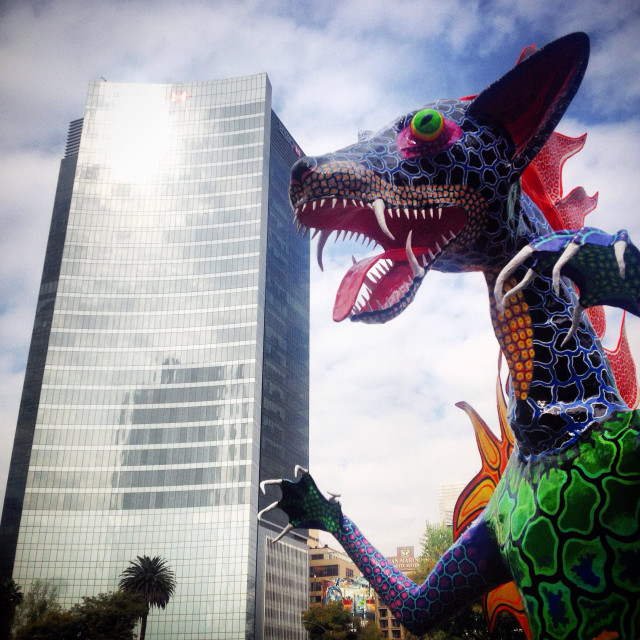"""A paper mache sculpture of a fantastic animal and a skyscrapper at the Parade of Alebrijes Monumentales in Reforma Avenue, Mexico City, Mexico. Art work called El Lobo by artist Miguel Linares Mendoza"" stock image"