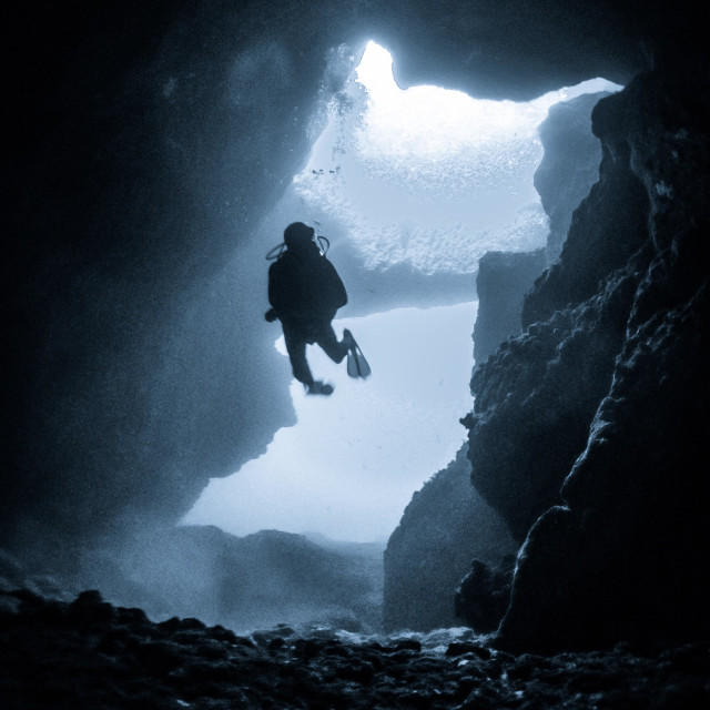 """""""Young male scuba diver swimming in the Blue Hole cavern"""" stock image"""