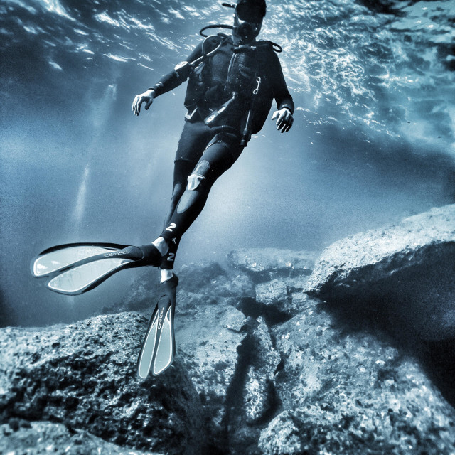 """""""Young male scuba diver hovering in the sea"""" stock image"""