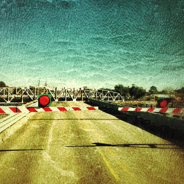 """""""Grungy colorful drawbridge closed for boat traffic"""" stock image"""