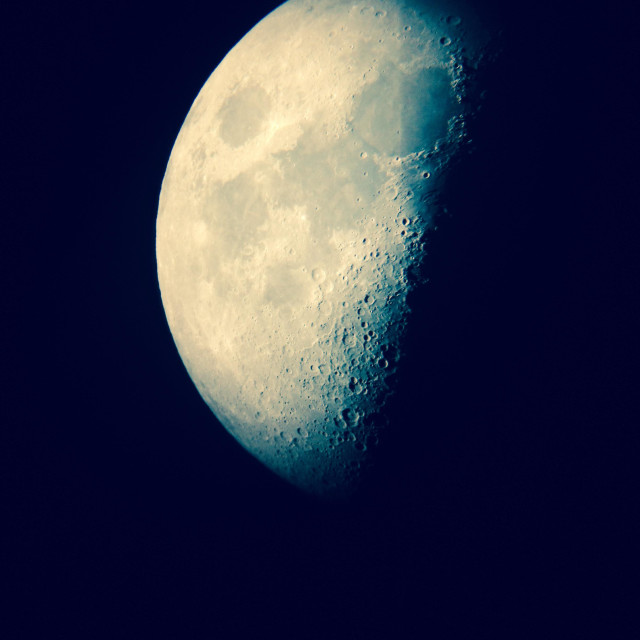 """""""Afocal telescope view of the first quarter moon in December"""" stock image"""