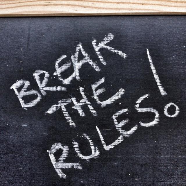 """""""The phrase Break The Rules written on a blackboard"""" stock image"""