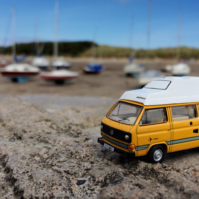 """Model VW T25 Transporter Westfalia Joker Camper Van by the sea at Beadnell Bay Northumberland"" stock image"