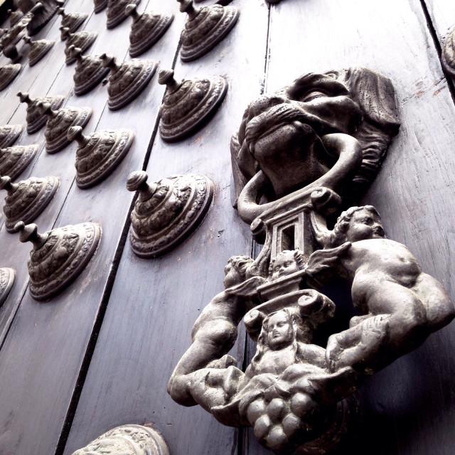 """Cherubs on a door knocker in Plaza De Armas. Central Lima"" stock image"
