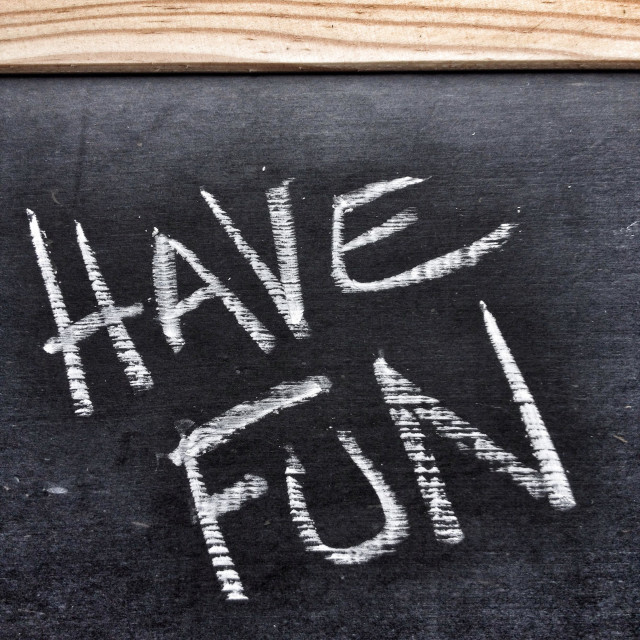 """The phrase Have Fun written on a slate blackboard"" stock image"