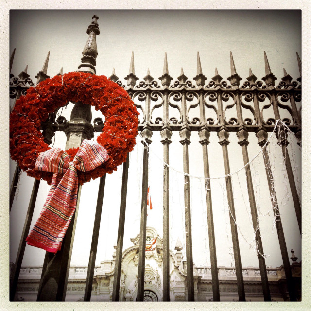 """""""Christmas wreath hanging on wrought iron fence in Plaza de Armas. Lima Peru"""" stock image"""