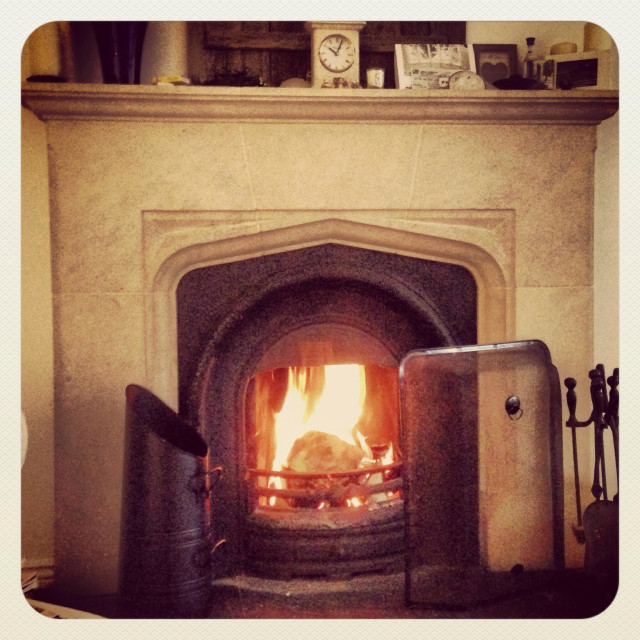 """""""A fire is seen lit for the winter evenings."""" stock image"""