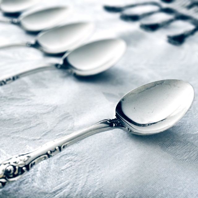 """Silverware on tablecloth"" stock image"