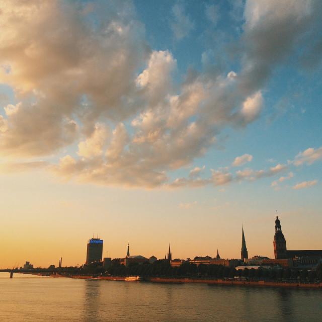 """Riga city skyline looking over Daugava river at sunset"" stock image"