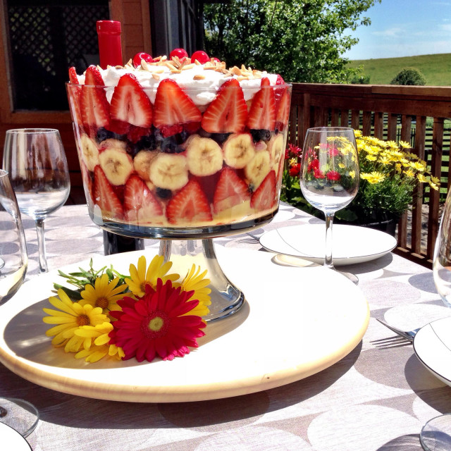 """""""Table set for dessert and wine on a sunny summer day."""" stock image"""