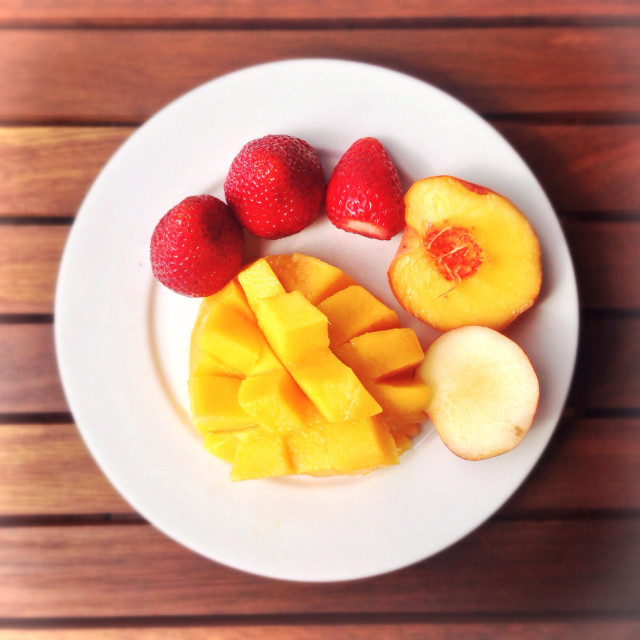 """Mango, strawberries and peach for a healthy breakfast."" stock image"