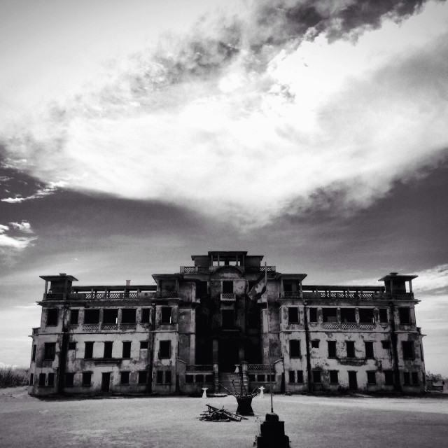"""""""The renowned Palace Hotel of Phnom Bokor. An enigmatic, desolate place that still whispers the stories of Cambodia's troubled past. Bokor, Cambodia."""" stock image"""
