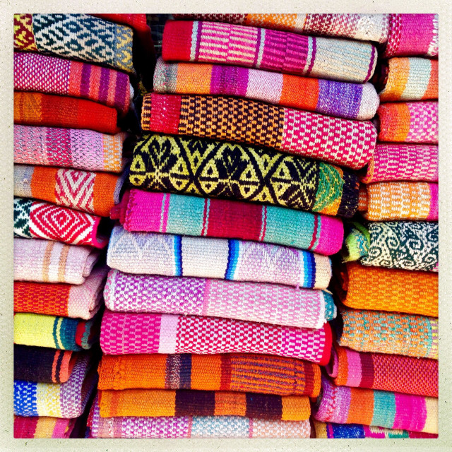 """""""Indian blankets stack up for sale to tourists"""" stock image"""
