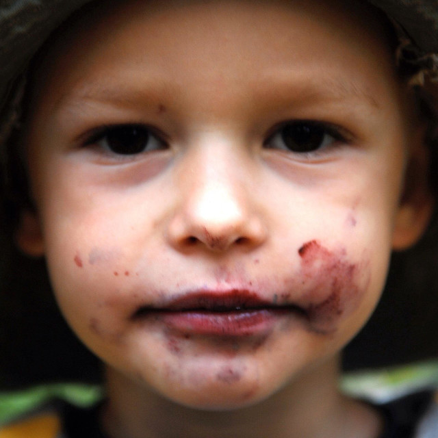 """Boy with dirty mouth by bilberry"" stock image"