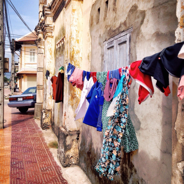 """Clothes drying in the streets of Kampot, Cambodia."" stock image"