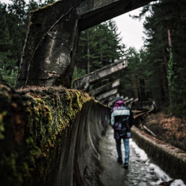 """Walking the old bob sled"" stock image"