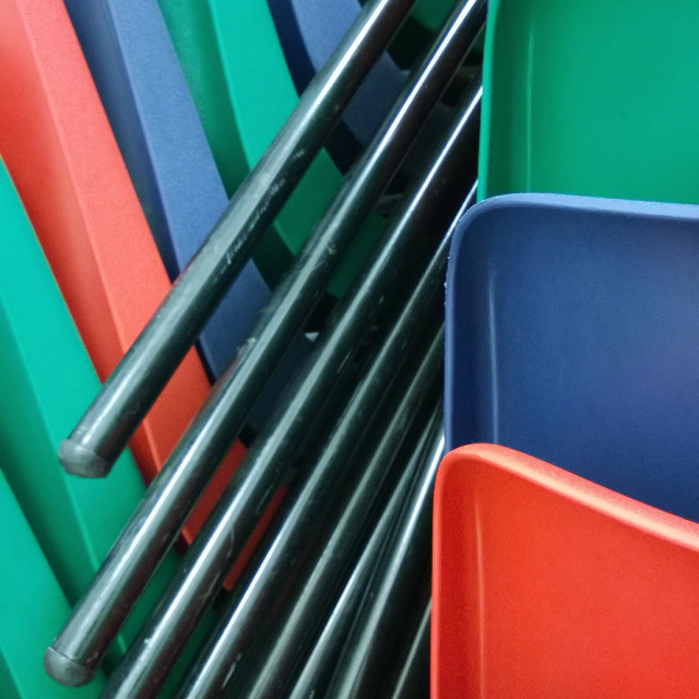 """""""Colourful plastic chairs stacked."""" stock image"""