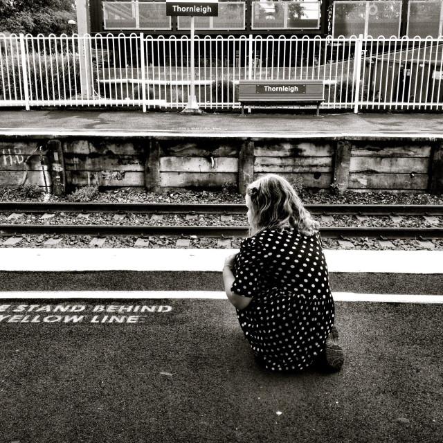 """Girl waiting at train station"" stock image"
