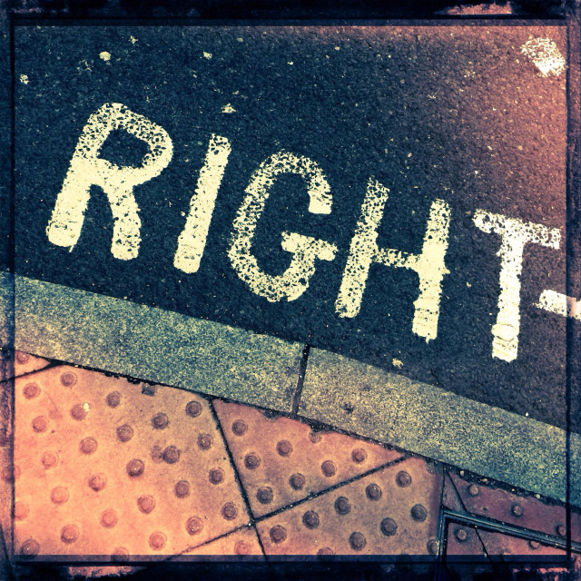 """""""Detail from on-street road markings showing the word 'Right'."""" stock image"""