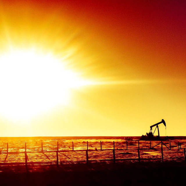 """Oil rig in the prairies of Alberta, Canada."" stock image"