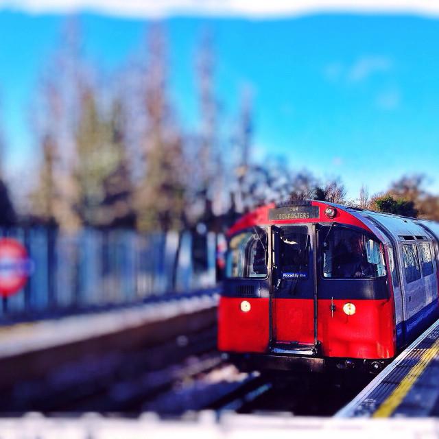 """Piccadilly Line train arriving at platform, London, UK"" stock image"