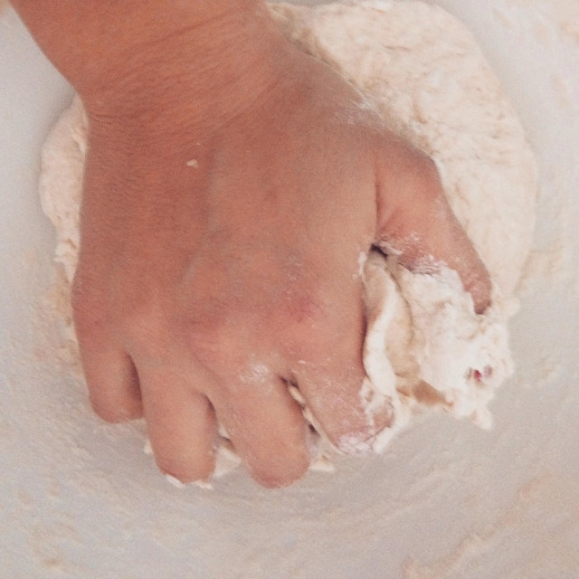 """Woman kneading dough"" stock image"