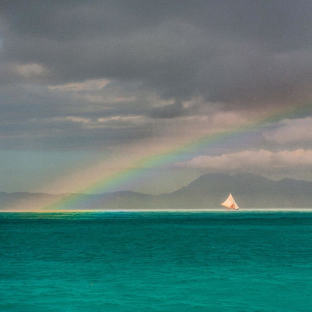 """""""Rainbow over the water with sailboat"""" stock image"""