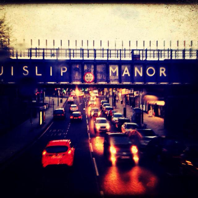 """Ruislip Manor railway bridge on a rainy day, London, UK"" stock image"