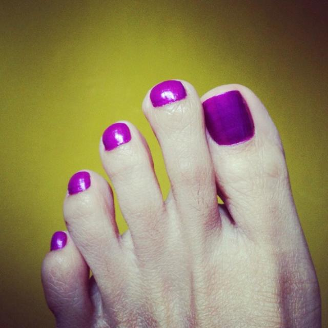 """Purple nail polish on yellow background"" stock image"