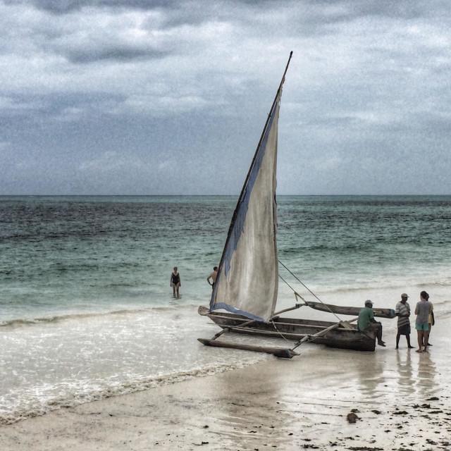 """Tradional fishingboat on the beach in Zanzibar."" stock image"