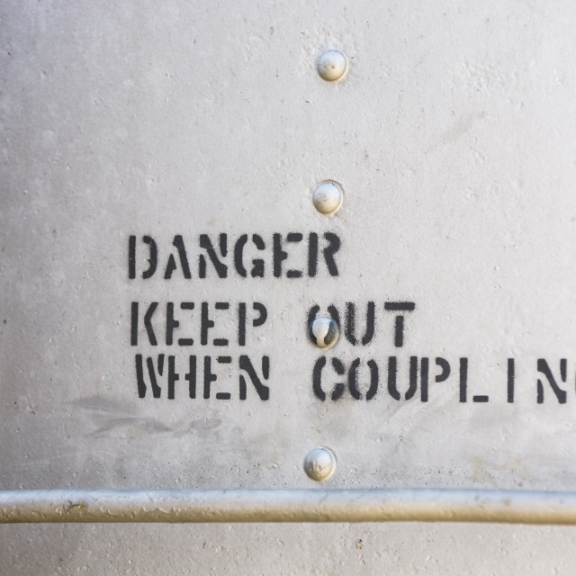 """Danger, Keep Out When Coupling"" stock image"