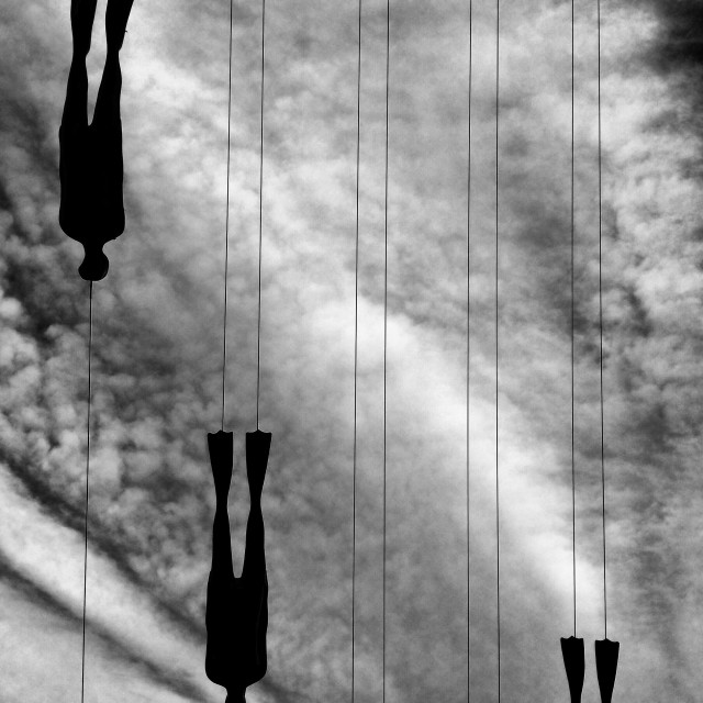 """Divers on a line"" stock image"