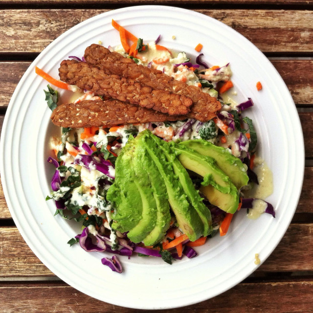 """""""Vegan lunch of tempeh, avocado and salad on white plate"""" stock image"""