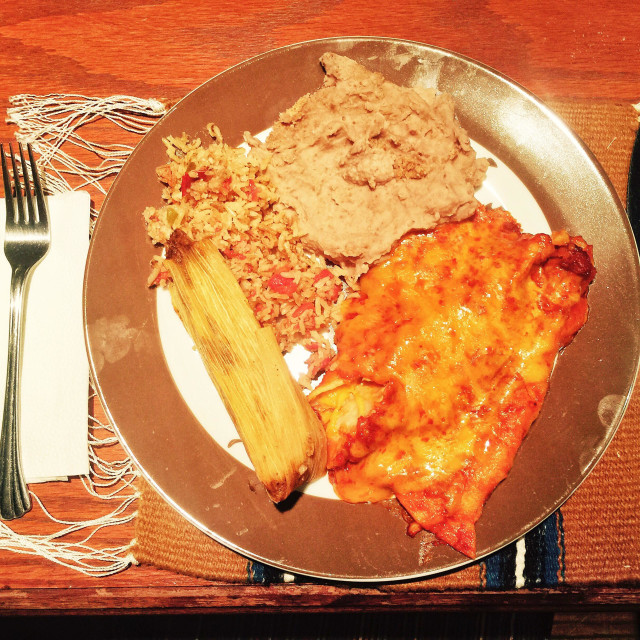 """""""Colorful Mexican dinner of enchiladas, re fried brand, rice and tamale"""" stock image"""