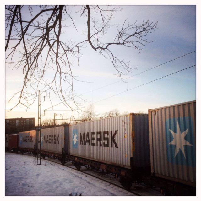 """""""Train with cargo containers. On its way true a winterlandscape."""" stock image"""