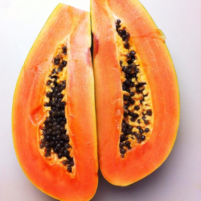 """""""Ripe papaya cut in half lengthwise"""" stock image"""