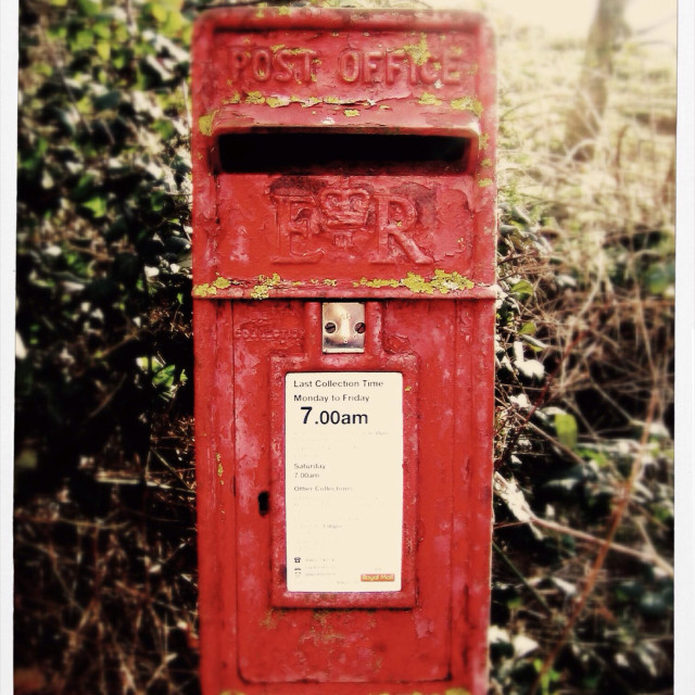 """""""A Royal Mail red postbox,letterbox on a british countryside lane."""" stock image"""
