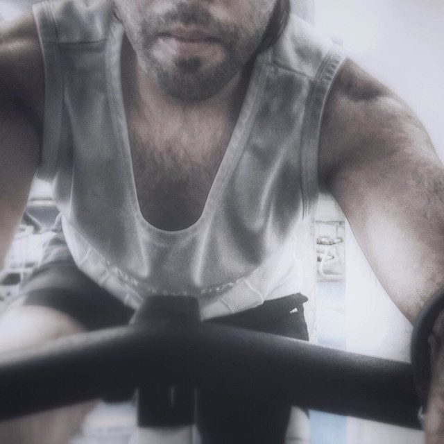 """""""A guy at the gym on a stationary bike"""" stock image"""