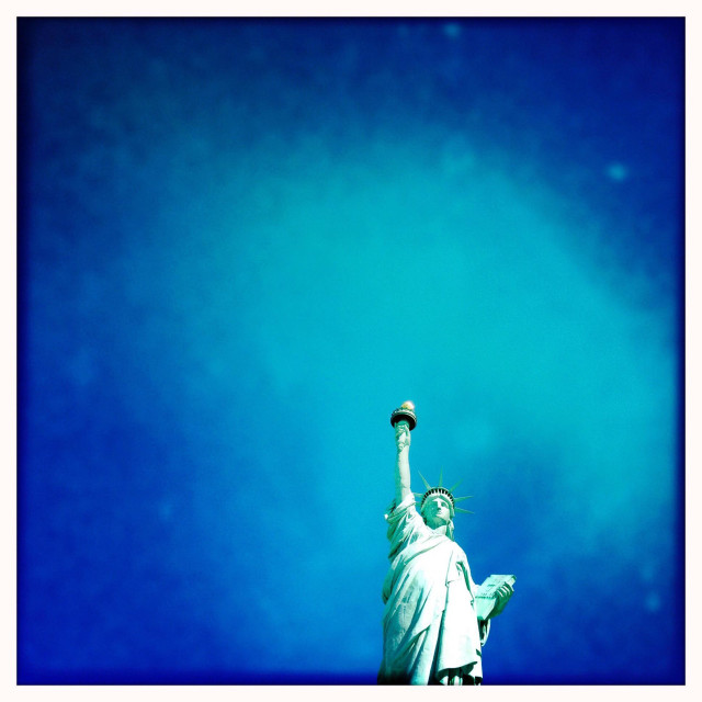 """Statue of Liberty with. blue skies."" stock image"