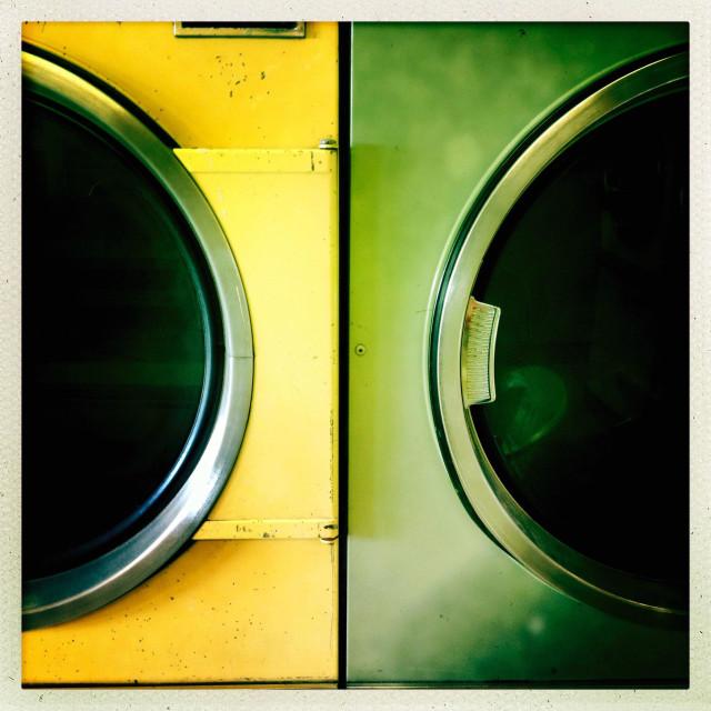 """Old laundromat dryers"" stock image"